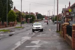 A white Nissan Qashqai was surrounded by debris after being smashed up.
