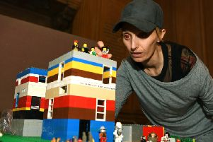 Bigger And Better In Leeds (BABIL), a free Autism Show at Leeds Civic Hall, with Harriet Chapman from Brick 42 and the Lego model representing each of the 8,000 children and adults in Leeds with autism.