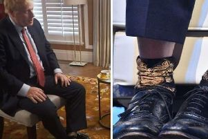 Boris Johnson pictured wearing the socks.