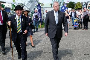 Prince Andrew, the Duke of York is given a tour of the show at Harrogate.