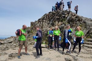 The Central Lancaster High School pupils take part in a boxing session at the summit of Snowdon.