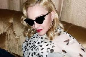 Pop star Madonna pictured wearing Burberry