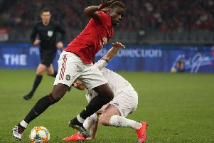 DIFFERENT CLASS: Manchester United's World Cup winner Paul Pogba takes on Leeds United midfielder Adam Forshaw. Picture by Paul Kane/Getty Images.