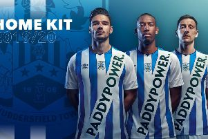 Sash of the day: Huddersfield's players sport the club's controversial new kit. (Picture: Huddersfield Town)