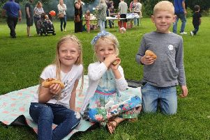Youngsters enjoying a snack at the fair.