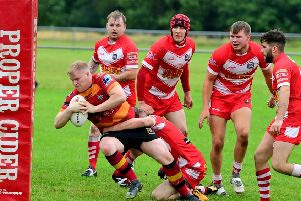 Dec Naughton forces his way over for a try during last Saturday's victory over East Leeds which boosted shaw Cross Sharks hopes of avoiding relegation from National Conference League Division Two. Pictures: Paul Butterfield