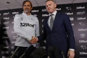 Wayne Rooney and Phillip Cocu at Rooney's unveiling on Tuesday.