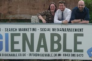 Liz Hardwick and Darren Jenkinson of DigiEnable with  Josh Vosper, Commercial Manager at Chorley FC (centre)