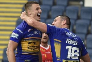Double try scorer Ash Handley celebrates with forward Brett Ferres. PIC: Matthew Merrick/Varley Picture Agency