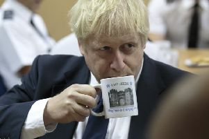 Boris Johnson during his visit to HMP Leeds.