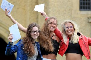 Joyous students celebrate their A-Level results.