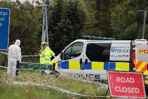 Police officers at the scene on Ufton Lane, near Sulhamstead, Berkshire, where a Thames Valley Police officer was killed whilst attending a reported burglary on Thursday evening. PRESS ASSOCIATION.