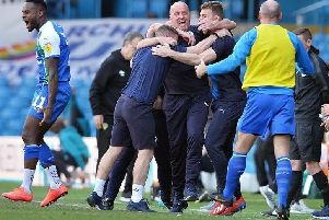Paul Cook and his staff enjoy a famous win at Leeds