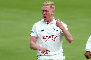 Luke Wood celebrates a wicket for Notts.