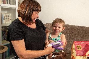Leeds' Connie Annakin, aged three, pictured with mum Caroline Day. She has been diagnosed with Batten disease, and her family are pleading over access to a new treatment that could extend her life but is deemed too costly.