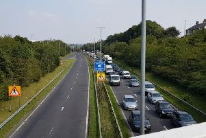 Traffic on Stanningley Bypass after a car crashed into the central reservation