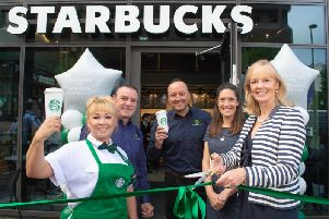 Starbucks store manager Magda Kubiak with Helen Green, associate director for Town Centre Securities and Starbucks staff.