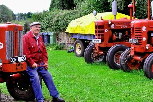 David Robinson sat amongst some of his vintage tractors that  he will be taking to  the  Hunton Steam Gathering.