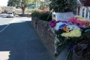 Floral tributes at the scene where Thomas Easton was fatally injured.