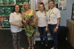 Tracy Brabin with staff from the Rainbow Baby Bank in Heckmondwike