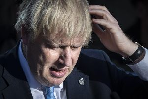 Britain's Prime Minister Boris Johnson reacts during a visit with the police in West Yorkshire. Photo: DANNY LAWSON/AFP/Getty Images
