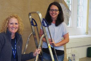 New teachers, Mrs Hunter and Mrs Stephenson, put the finishing touches to the classroom facelift. Photo: Submit