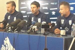 Huddersfield Town manager Danny Cowley (centre) flanked by assistant Nicky Cowley (left) and director of football operations David Webb (right).