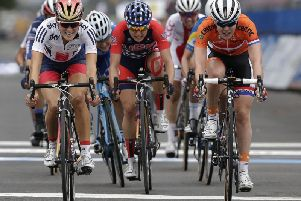 Elizabeth Armitstead, left, of Great Britain, passes Anna Van Der Breggen, right, of the Netherlands and Megan Guarnier, center, of the United States to the line to win the Women's Elite road circuit cycling race at the UCI Road World Championships in Richmond (AP Photo/Gerry Broome)