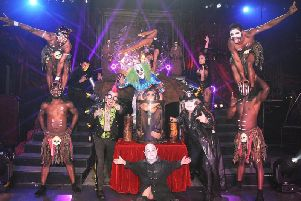 Circus of Horrors cast with Pickled Person in a bottle (centre).