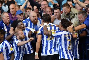 Mobbed: Fans join in with Owls players in congratulating scorer Atdhe Nuhiu.