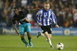 Remember this?: Wednesday's Barry Bannan escapes Arsenal's Glen Kamara in the 2015 Capital One League Cup encounter.