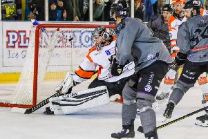 Jared Aulin fires back-handed past Pavel Kantor in the Sheffield Steelers' goal. Picture: Mark Ferriss/EIHL.
