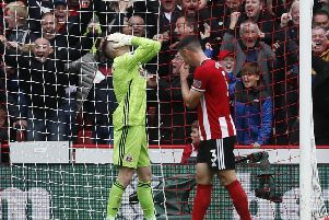Dean Henderson of Sheffield Utd reacts after the ball squirmed under him to concede the winning goal against Lverpool. Picture: Simon Bellis/Sportimage