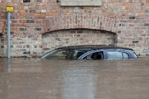 A car submerged after the River Ouse burst its banks in March (Photo: PA/Danny Lawson)