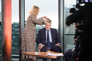 Prime Minister Boris Johnson prepares for a TV interview at the Tory conference which has been overshadowed by questions about his personal conduct.