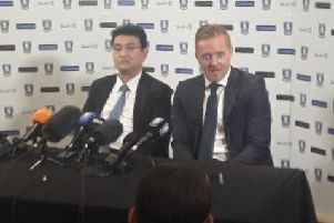 Garry Monk (centre), pictured with Sheffield Wednesday chairman Dejphon Chansiri (left).