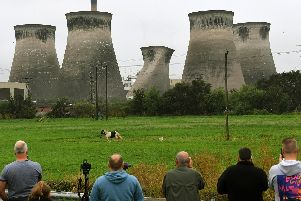 People watch the demolition of one of the cooling towers at Ferrybridge Power Station.