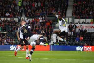 Florian Jozefzoon (right) challenges Ryan Tunnicliffe during the win over Luton. Photo: Kristen Goodall