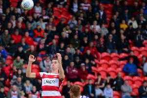 Eyes on the ball: Doncaster Rovers' Ben Sheaf.