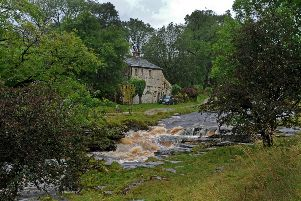The River Wharfe in full spate in Yockenthwaite in the Yorkshire Dales after heavy rain.  Picture: Tony Johnson.