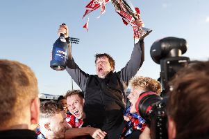 CROWNING GLORY: Barnsley manager Daniel Stendel celebrates promotion with his players at Bristol Rovers' Memorial Stadium. Picture: Darren Staples/PA.