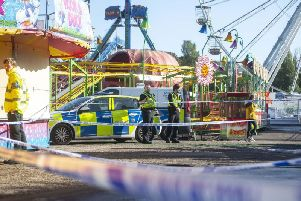 Police monitor a cordon around two rides at Hull Fair after a woman fell from one ride and landed on another Picture: Dan Rowlands / SWNS.com