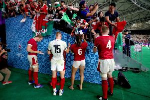 Wales players sign autographs for fans at the end of the 2019 Rugby World Cup Pool D match at Oita Stadium, where England's game with France could be moved to (Picture: David Davies/PA Wire)