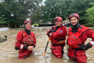 Pete Roe, Dave Rutter and Adam Bradley, of Swaledale Mountain Rescue Team, waist deep in flood water in the village of Fremington. Picture by Swaledale Mountain Rescue Team.