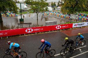 Riders pass the flooded fan zone on the Stray, Harrogate during the UCI World Championships 2019.
