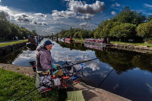 Angler Richard Marper by the Aire and Calder canal at Stanley Ferry near Wakefield.