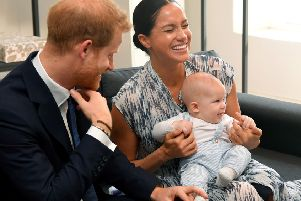 The Duke and Duchess of Sussex holding their son Archie during a meeting with Archbishop Desmond Tutu and Mrs Tutu at their legacy foundation in cape Town, on day three of their recent tour of Africa.