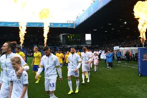 Leeds United's Luke Ayling leads the players out as the fireworks go off at Elland Road.