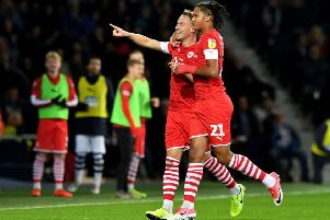 Reds' joy: Barnsley's Cauley Woodrow celebrates scoring his side's second goal against West Bromwich with Toby Sibbick.