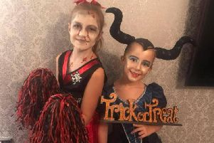 Evie and Sienna as a Zombie Cheerleader and Maleficent.